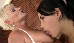 Old and juvenile fruity babes take a steam bathroom and lick some bald pussy