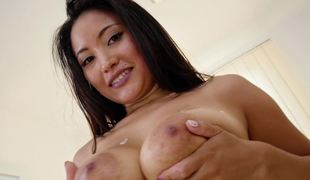 A whore with some huge tits is sucking a hard dick with her face