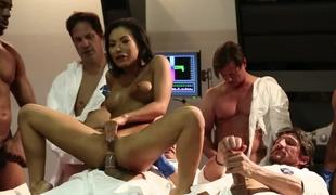 A group of men stand around this Asian chick, fucking her hard