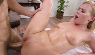 A blonde on the massage table manages to suck a big wang like a pro