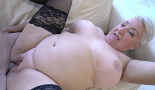A fat nasty old woman has her large tits screwed well this day