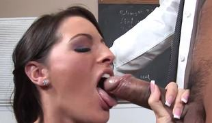 Teen is in front of blackboard, getting her taut cunt licked