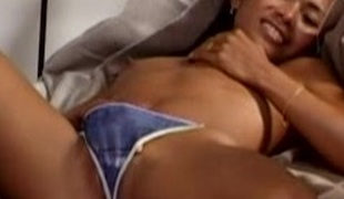 Good-looking brunette solo model just about small gut enjoys masturbating close near