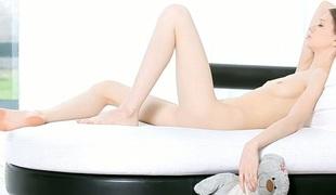 Pretty darling in lengthy stockings is easing her lusty needs