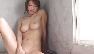 Cute Asian hotty fingers her hairy slit in the bathtub