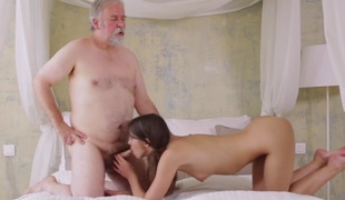 Young Marisa was feeling pretty lustful and even though this stud was old she had to suck on his cock!