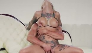 A chick with tattoos is getting her pussy slammed by the hard cock