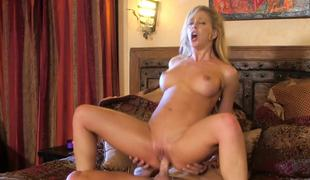 A blonde with a hot round ass is having her pussy stretched by cock