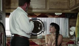 A bimbo is on top of a dude with a beard, having her pussy rammed