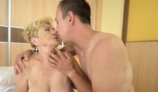 Granny with some saggy billibongs is having her old fat body fucked hard