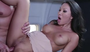 A hot bimbo is getting drilled on the plane by her lover