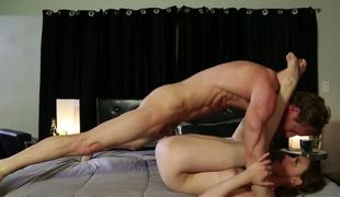 A brunette is getting fucked in the missionary position on the sofa