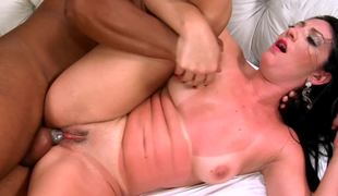 A big dark guy penetrates a hottie with prominent tan lines